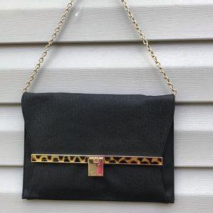 Ivanka Trump leopard stripe envelope bag